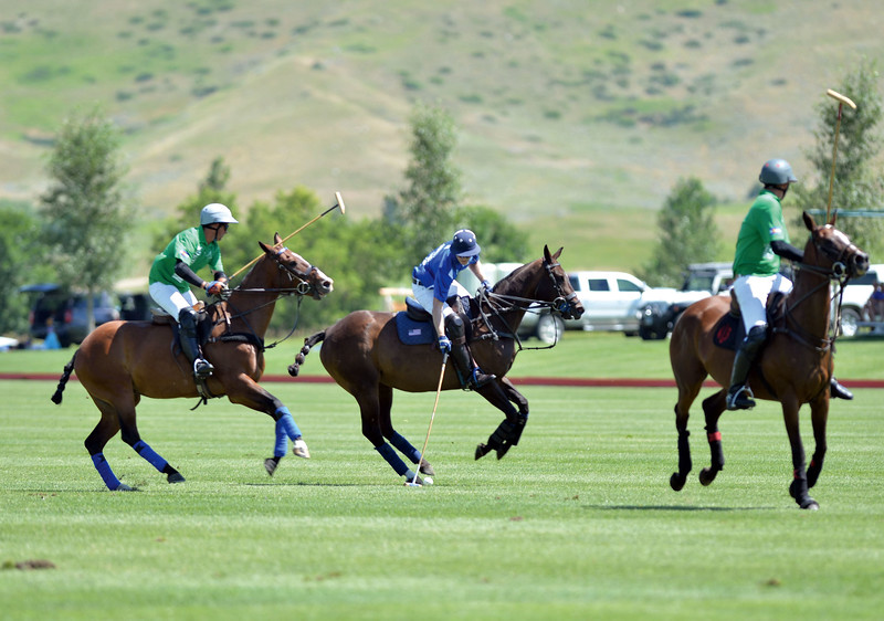 Joel Moline | The Sheridan Press<br /> Jeff Blake striking the ball between two defenders at the Flying H Polo Club Thursday, Aug. 1, 2019.