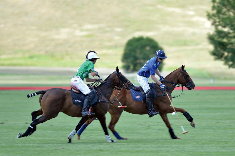 Joel Moline | The Sheridan Press<br /> Sugar Erskine rides alongside Jeff Blake, who is advancing the ball down the polo pitch at the Flying H Polo Club Thursday, Aug. 1, 2019.