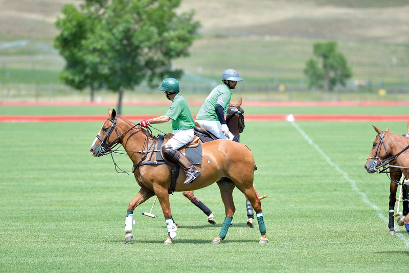 Joel Moline | The Sheridan Press<br /> Tom Sprung and Nicolai Galindo moves into postions at the Flying H Polo Club on Thursday, Aug. 1, 2019.