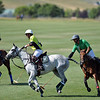 Joel Moline | The Sheridan Press<br /> Miguel Astrada moves the ball down the field with defender Nicolai Galindo close behind him during the Skeeter Johnnson Cup Final at the Flying H Polo Club Saturday, Aug. 3, 2019.