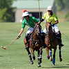 Joel Moline | The Sheridan Press<br /> Sugar Erskine moves the ball down the field with Craig Duke close behind him during the Skeeter Johnnson Cup Final at the Flying H Polo Club Thursday, Aug. 3, 2019.
