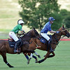 Joel Moline | The Sheridan Press<br /> Sugar Erskine rides alongside Jeff Blake, who advances the ball down the polo pitch at the Flying H Polo Club Thursday, Aug 1, 2019.