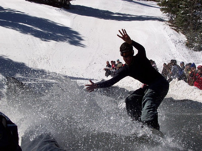A pond-skimming snowboarder at Sipapu shows good style.