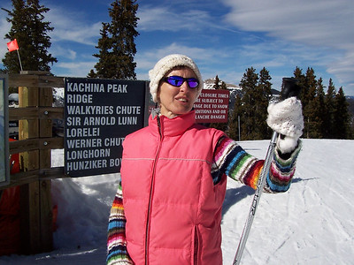 Caroline checks out the view from the top of Taos Mountain.
