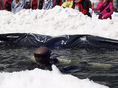 A pond-skimming snowboarder at Sipapu goes for a swim.