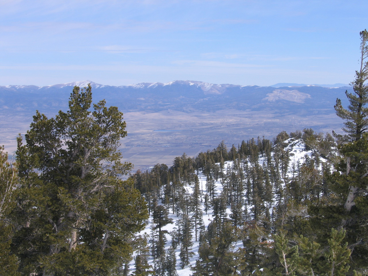 Snowy mountains and the vast dryness of Nevada.