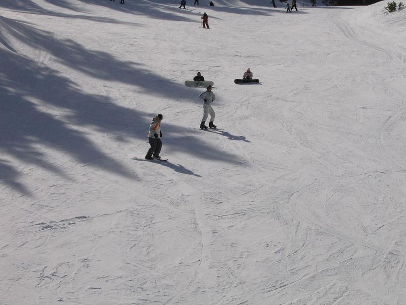Carrie teaches Linda how to skiboard.