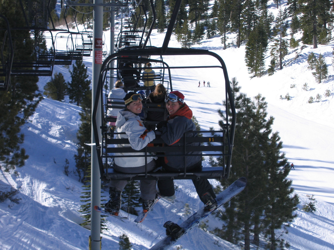 Carrie and Becky ride the lift at Heavenly.