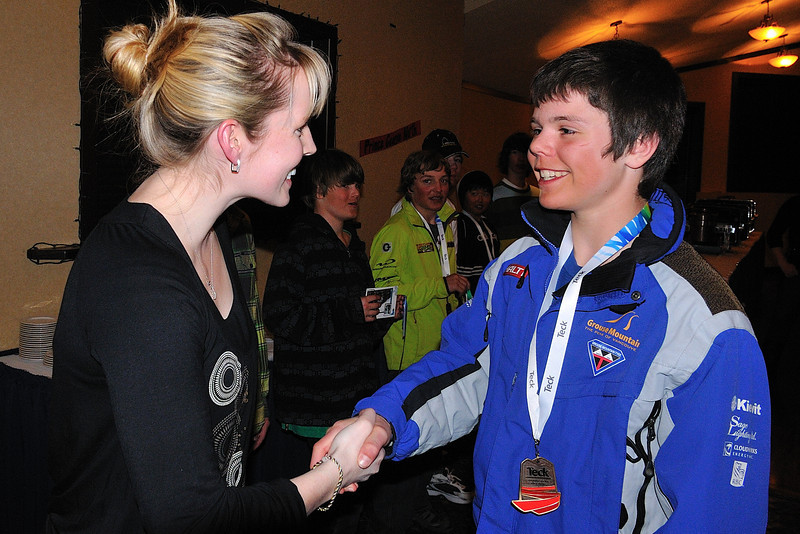 Kelly Vanderbeek presents a gold medal for slalom to Sam Mulligan, Grouse Tyee Ski Club, who would be crowned overal K1 boy's champion later on the weekend.