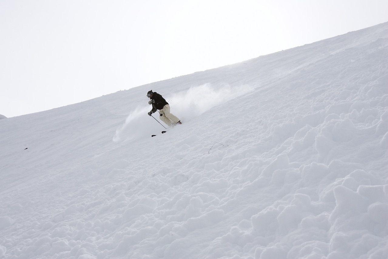 The skier is fully in the fall line, gliding naturally downhill. This moment feels a little like zero G.