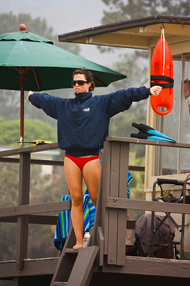 Signaling the other lifeguards.