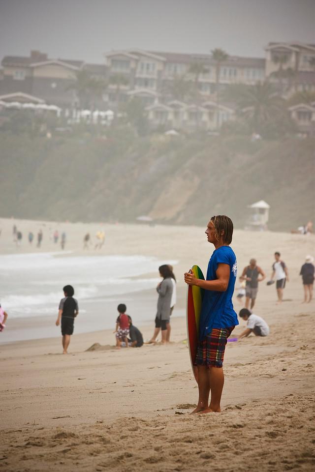 Evaluating the surf break.