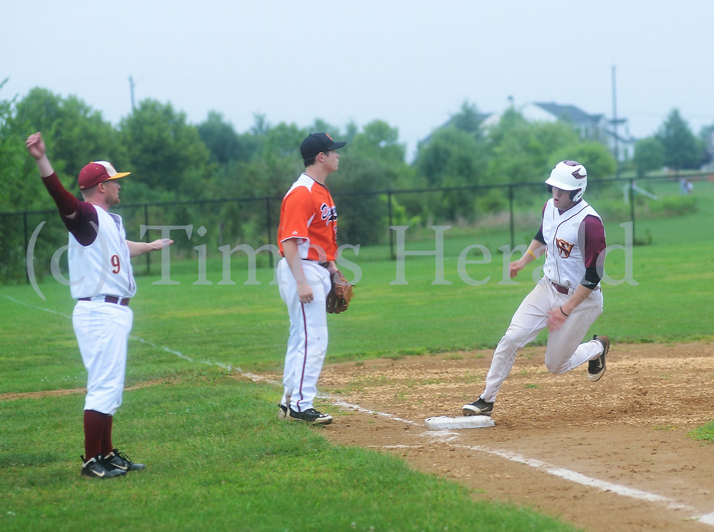 . Rob Zinsmeister gets waved to run to home to score the first run of the game for Skippack.  Friday, August 1, 2014.  Photo by Adrianna Hoff/Times Herald Staff.