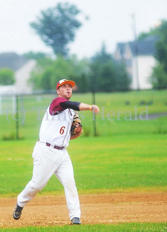 . Skippack\'s Jason Brooke makes a throw to first base for the out.  Friday, August 1, 2014.  Photo by Adrianna Hoff/Times Herald Staff.