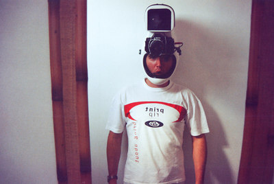 Testing the new camera helmet. The Maxxum SLR is tongue triggered. The helmet + hi8 camera + 35mm camera weights 17 pounds (8 kg). Talk about neck ache.