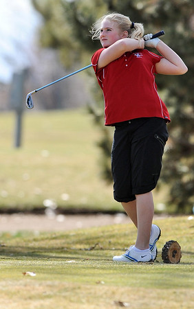 GOLF08<br /> Fairview's Kelly Moran tees off at the 17th hole of the Skyline Invitational golf tournament in Longmont.<br /> Photo by Marty Caivano/Camera/March 22, 2010