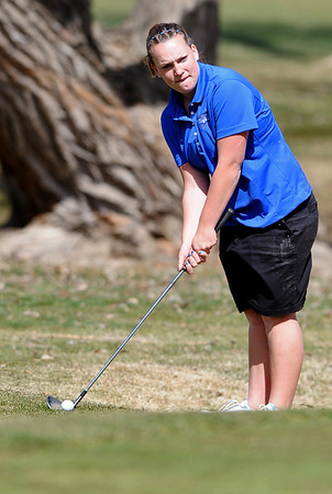 GOLF07<br /> Broomfield's Danielle Dorans prepares to chip onto the green at hole 16 of the Skyline Invitational golf tournament in Longmont.<br /> Photo by Marty Caivano/Camera/March 22, 2010