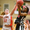 S0123BASKET8<br /> Erie's #53 Piper Zeier fights for a rebound against Skyline's #24, Deandra Elcock, during their game at Erie High School on Tuesday evening, January 22nd, 2013.<br /> <br /> Photo by: Jonathan Castner