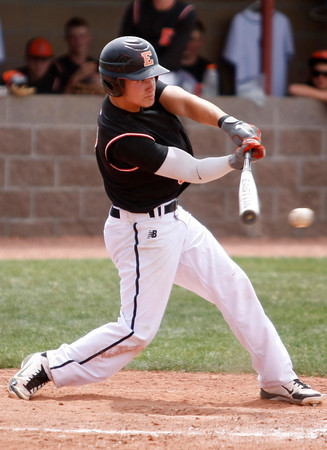 "Erie's Coltin Brink, #3, swings at the ball on Saturday, May, 5, 2012, Eire.<br /> Photo by Derek Broussard<br /> For more photos visit  <a href=""http://www.dailycamera.com"">http://www.dailycamera.com</a>"