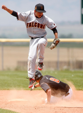 """Skyline's, Tyler Hamby, #1, leaps over Erie's Joe Ramey, #8, as Ramey slides into second base  on Saturday, May, 5, 2012, Eire.<br /> Photo by Derek Broussard<br /> For more photos visit  <a href=""""http://www.dailycamera.com"""">http://www.dailycamera.com</a>"""