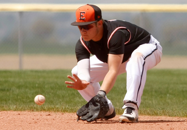 """Erie's Brandon Moore, #9, scoops up a line drive on Saturday, May, 5, 2012, Eire.<br /> Photo by Derek Broussard<br /> For more photos visit  <a href=""""http://www.dailycamera.com"""">http://www.dailycamera.com</a>"""