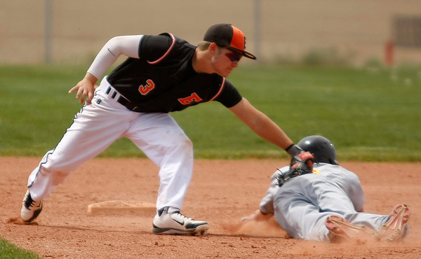 "Erie's Coltin Brink, #3, tags out Skyline's Justin Forsyth, #4, before he can reach second base on Saturday, May, 5, 2012, Eire.<br /> Photo by Derek Broussard<br /> For more photos visit  <a href=""http://www.dailycamera.com"">http://www.dailycamera.com</a>"