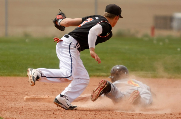 """Erie's Coltin Brink, #3, tags out Skyline's Justin Forsyth, #4, before he can reach second base on Saturday, May, 5, 2012, Eire.<br /> Photo by Derek Broussard<br /> For more photos visit  <a href=""""http://www.dailycamera.com"""">http://www.dailycamera.com</a>"""
