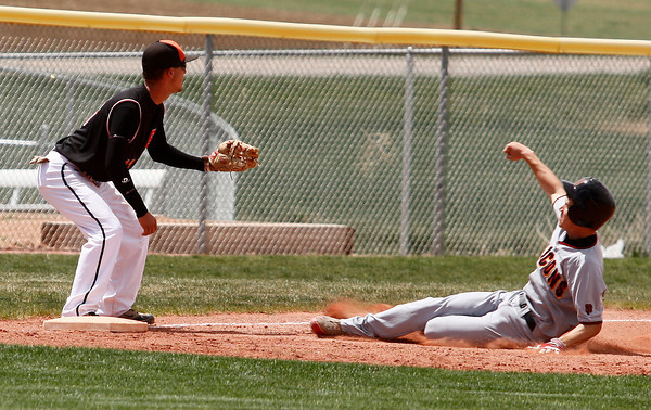 """Skyline's Garrett Angstead, #7, slides safe into third base before Erie's Dillon Reider, #17, can tag him out on Saturday, May, 5, 2012, Eire.<br /> Photo by Derek Broussard<br /> For more photos visit  <a href=""""http://www.dailycamera.com"""">http://www.dailycamera.com</a>"""