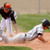 "Erie's Kyle Leahy, #12, is unable to tag out Skyline's Andrew Stoops, #3 as he slides safe back to second base on Saturday, May, 5, 2012, Eire.<br /> Photo by Derek Broussard<br /> For more photos visit  <a href=""http://www.dailycamera.com"">http://www.dailycamera.com</a>"