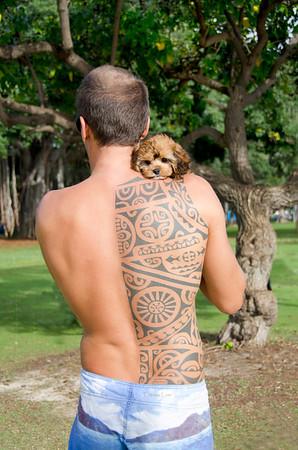 Olivier, great Polynesian tattoo.  Is the doggie's name Kapa?   ParadisePhotos808@gmail.com   Mahalo, Patricia