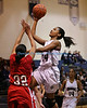 Manorville NY: Southampton's Paris Hodges #24 goes up for a jump shot in the first quarter over Center Moriches defender Victoria Marton #32 in the Suffolk Girls HS Basketball Class B finals at Eastport-South Manor High School. (Feb. 19, 2013)  Photo by Daniel De Mato