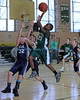 Riverhead  NY: Ahkee Anderson #23 of undefeated St. Patrick's CYO Basketball team goes up for the shot over Liam Rego #32 of Our Lady of the Hamptons at Mercy High School for Suffolk Times <br /> (Feb. 17 2013) Photo by Daniel De Mato