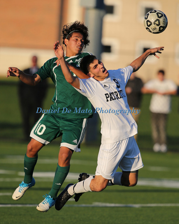 East Setauket NY, October 22, 2012 Brentwoods Carlos Escobar #10 heads the ball over Ward Melville's Kyle Honer #9 during Brentwood High Schools 2-0 win at Ward Melville HS.