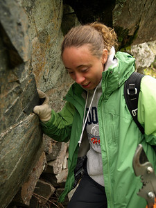 Stacie negotiating a steep descent in mountaineous northern Minnesota.