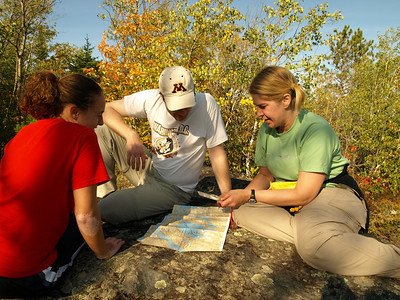 After a day of hard work, volunteers learn mamp and compass skills.   Maps for this trip were donated by McKenzie Maps  www.bwcamaps.com
