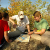 "After a day of hard work, volunteers learn mamp and compass skills.   Maps for this trip were donated by McKenzie Maps   <a href=""http://www.bwcamaps.com"">http://www.bwcamaps.com</a>"