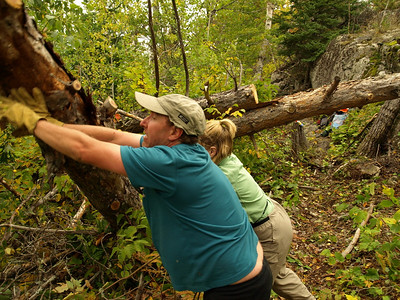 """Tipping the log on the side of the trail.  BWA Committee volunteers are trained in not creating the """"parking lot barrier"""" syndrome.  Proper disposal makes for more estheticaly pleasing wilderness trails."""