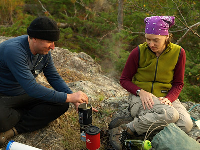"""Joe and Jen rehydrating spaghetti and hamburger on Jetboil stove.  Stoves are a subject of discussion.  Some campers exhibit so called """"stove envy"""".  Ken brought super miniature Snowpeak compressed gas stove.  I nearly burned my Optimus 111B to the ground after neglecting to shut off the valve during priming burn.  Blame it on not fully awakening early in the morning."""