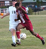 12 for Dobyns Bennett pushes past 15 for Science Hill as he moves the ball down field. Photo by Ned Jilton II