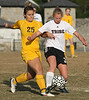 DB #3 Katie Clark takes the ball from Crockett #25. Photo by Erica Yoon
