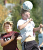 #3 for D-B jumps up in front of #12 for Morristown West and heads the ball away. Photo byNed Jilton II