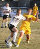 DB #23 Julie Gillmer tries to block the ball from Crockett #18 Nicole Saam. Photo by Erica Yoon