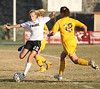 DB #25 Haley Phipps tries to kick the ball away from Crockett #18 Nicole Saam. Photo by Erica Yoon