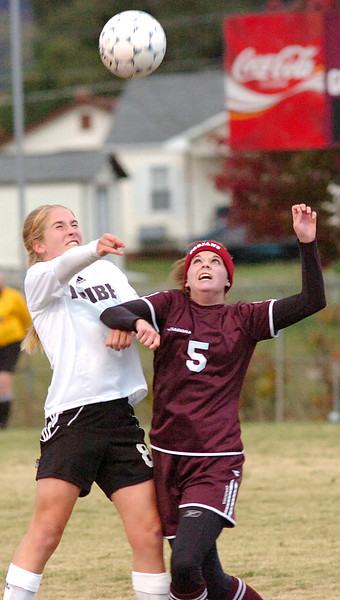 #8 for D-B battles with #5 of Morristown West for position as the ball comes down. Photo by Ned JIlton II