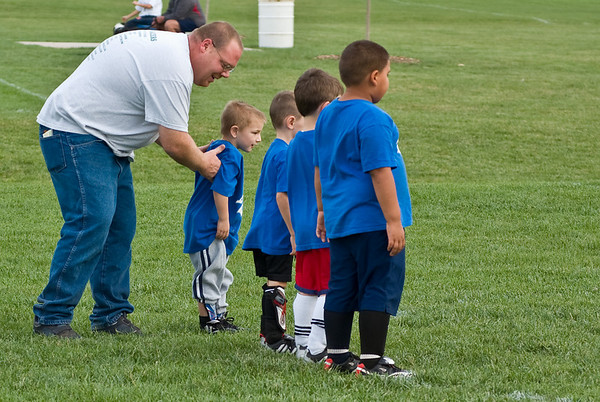 The coach arranges his team.