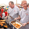Paul Patterson and Doug Haseltine grilling up hot dogs for the Salvation Army picnic and silent auction. Photo by Ned Jilton II