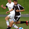 #9 for Science Hill gets between #8 of Sullivan South and the ball during Dist1 action. Photo by Ned Jilton II