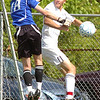 #8 for Sullivan South battles with #18, the Knox Bearden goalie at the goal early in the match. Photo by ned Jilton II