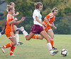 #4 for Dobyns Bennett splits the Central defenders for a kick on goal. Photo by Ned Jilton II