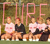 "With the field and players deck out in pink and a big ""kick for the Cure"" sign over their bench, the Lady Indians take on THS in the second annual Susan G. Koman ""Kick for the Cure "" soccer match. Photo by Ned Jilton II"